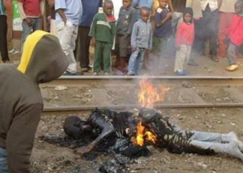 20140303193150-hombre-quemado-vivo-en-uganda.jpg